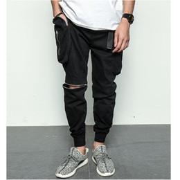 Pantalones holgados blancos para hombre online-negro blanco bolsillos grandes de la calidad de carga de cremallera para hombre holgados pantalones de hip hop streetwear basculador del harem de los pantalones de deporte de los pantalones