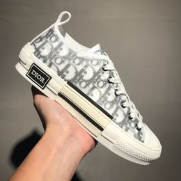 Chaussures haut de gamme en Ligne-Les dernières chaussures de luxe pour hommes 19SS OBLIQUE Homme X Kaws de Kim Jones hommes femmes chaussures décontractées taille haute baskets taille EUR 35-45