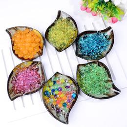 Palle di gelatina magica crescente online-Perle di acqua Perle di cristallo Perle di acqua Bio Gel Ball Per Fiore / Diserbo fango Grow Magic Jelly Balls 1KG / 50000 Pz