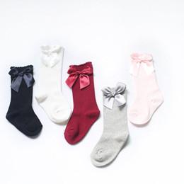 Cotone Cute Baby Toddler Baby Girl Knee High Long Bow Casual calza solida 0-4T da calzamaglia di progettazione invernale fornitori