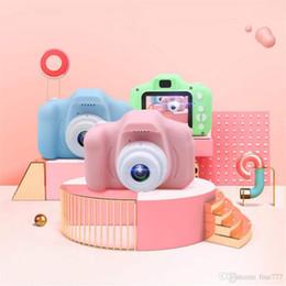 Mini cámara digital para niños online-2 pulgadas de pantalla HD mini cámara digital recargable para niños de dibujos animados lindos juguetes de cámara accesorios de fotografía al aire libre para regalo de cumpleaños infantil