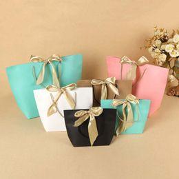 2019 geschenkbeutel papier boutique 5 Farben-Papier-Geschenk-Beutel-Boutique Kleidung Verpackungsbeutel mit Bogen-Band-elegante Pappe Paket Einkaufstaschen ZZA1419 günstig geschenkbeutel papier boutique
