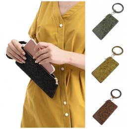 Популярные брелки онлайн-Популярные Keychains браслет Pu Leather Pure Color Flower Designs Key Ring Напульсник Lady Girls Wrap браслет Travel Сувениры Новое прибытие 18