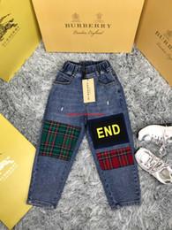 Algodão patch tecidos on-line-Crianças jeans crianças roupas de grife moda charme outono meninos e meninas algodão denim tecido calças xadrez patch design