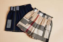 kleidung kinder koreanischen marken Rabatt Facoty Marke 2019 Sommer neue koreanische Kinderbekleidung Jungen und Mädchen Baumwolle Plaid Shorts beiläufige Kinderhosen