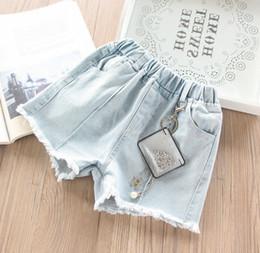 a6d8aa10ce Niños pantalones cortos de mezclilla verano niñas perla metal cadena  colgante jean shorts niños cintura elástica doble bolsillo vaquero  pantalones cortos ...