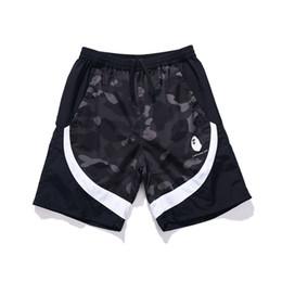 Decoracion playa online-Pantalones Pantalones cortos para hombre Bape diseñador para hombre de la playa del verano de moda para hombre de las mujeres de impresión de camuflaje flojos de los pantalones cortos de la cremallera de la decoración