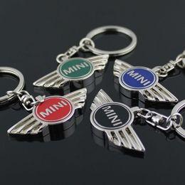 audi fernbedienungen Rabatt Für MINI Cooper 4colors Autobots Angel Wings Marke Sportwagen Symbol Schlüsselanhänger Schlüsselanhänger Metall Auto Auto Mini Wing Logo Schlüsselanhänger