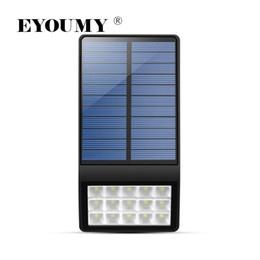 Decorazioni di recinto di natale online-Eyoumy Wall Fence Lampada solare Luce da giardino Sensore di movimento impermeabile Luce solare a LED Decorazione esterna Luce solare di Natale DHL