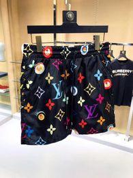 calientes grandes caderas negras Rebajas Pantalones EE mayor del verano forman los cortocircuitos nuevo diseñador de la tabla corta de secado rápido traje de baño de impresión de cartón playa de los hombres pone en cortocircuito para hombre