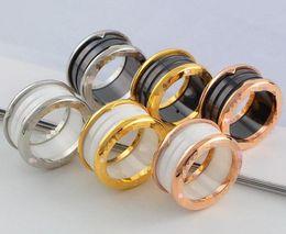 Anéis largos para mulheres on-line-Hot clássico marca bv cerâmica anéis de aço inoxidável anel de amor grande anel de cerâmica para mulheres homens casais anel de casamento anéis finos atacado