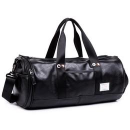 Hommes Grand Sacs De Voyage Pliable Duffle Bag Business Week-end PU Rivet Cover Femmes Épaule Messenger Sac Organizer Drum ? partir de fabricateur