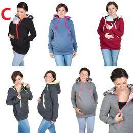 2019 chaqueta de invierno mujeres embarazadas Baby Carrier Jacket Kangaroo Hoodie Winter maternidad con capucha prendas de abrigo abrigo para mujeres embarazadas llevar bebé embarazo ropa chaqueta de invierno mujeres embarazadas baratos