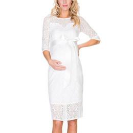 Vestidos de maternidade soltos on-line-Vestido de mulher grávida roupas de maternidade parágrafo curto manga de sete quartos laço em torno do pescoço flor solta cintura oca 28
