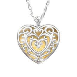Modèles de collier simples en Ligne-Style ethnique Bohème Métal Simple Mode Pêche Coeur Motif Collier Creux Pendentif Charme Collier Court Femme