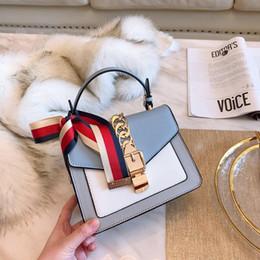 Argentina Marcas famosas de lujo bolsos de diseñador de cuero genuino bandolera bandolera bandolera BOW-TIE de seda colorida bolsa de solapa de dos tonos cheap genuine leather colorful handbags Suministro