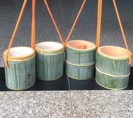 Argentina Envío gratis jardín de infantes niño Bamboo tubo zancos pisar los zapatos de estilete de bambú deportes al aire libre equipo de entrenamiento de equilibrio Suministro