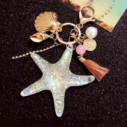 Argentina FancyFantasy Hot New Cartoon Sea World Starfish Pearl Shell llavero llavero llavero de cristal colgante llavero regalo de las mujeres Suministro