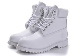 Qualidade superior 100% couro genuíno Marca inverno botas de neve homens mulheres botas ao ar livre sapatos de couro de vaca sapatos de caminhada de Fornecedores de marcas de caminhadas topo