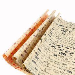 Accesorios de papel de envolver online-75 * 52 cm Papel de envolver Periódico Vintage Envoltura de regalo Paquete de embalaje de Artware Papel Kraft de Navidad Color Accesorios de color