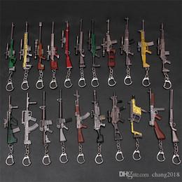 pistola cs Rebajas 2019 Juego Caliente 37 Estilos PUBG CS GO Arma Llaveros AK47 Modelo de pistola 98 K Rifle de Francotirador Anillo de la cadena dominante para los regalos de los hombres 12 CM 190426