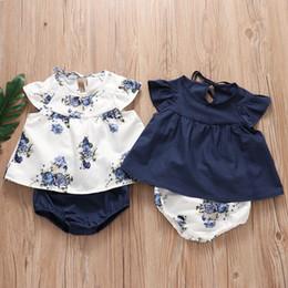 Pantalones cortos para bebé niña online-2019 niñas bebés 2 pcs juegos de impresión floral jumper tops + pantalones cortos de PP al por mayor bebés bebés ropa de niños