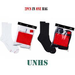 Imballare un sacchetto online-Classic box logo WOMEN'S MEN'S Crew Socks UNHS 2 CONFEZIONI in un sacchetto 1 NERO + 1 BIANCO SPEDIZIONE GRATUITA MARCA NUOVO
