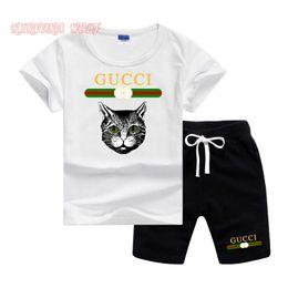 Pantalon negro estampado online-GC Cat Logo Diseñador de moda de lujo traje de niño para niños pequeños Baby Boy Outfits ropa caliente negro cabeza de gato camiseta impresa pantalones superiores 2pcs