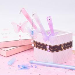 stylo à colle en gros Promotion 1 PC Mignon Papillon Stylos Pendentif Neutre Stylos Kawaii Cristal Gel Pour Enfants Cadeau École Fournitures De Bureau Papeterie