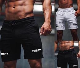 Pantaloncini sportivi sottili da uomo online-Uomo sportivo Sport Beach Outdoor Shorts Fashion Fitness Cotone Slim pantaloni con coulisse lunghezza del ginocchio pantaloni S-XXL