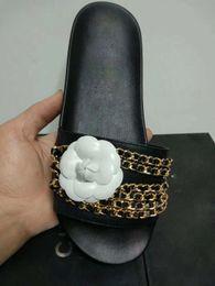 pantoufles de logo Promotion 2019 Mode marque logo chaîne en caoutchouc fond plat dames sexy chaussures de sport Hotsale plein air brillant chaussures chaîne pantoufles avec de vraies images