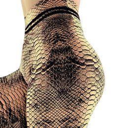 Leggings serpientes online-NORMOV Mujeres Yoga Fitness Push Up Leggings Pantalones de entrenamiento de cintura alta Legging Moda Mujer Piel de serpiente Leggings impresos 2019