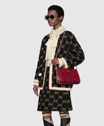 2020 diseños de faldas para mujer Las mujeres del diseño de la vendimia de lujo TRAMO viscosa vestido de dos piezas Tops camisa chaqueta de punto + falda de Midi Letra camisa de vestir de la flora Ajuste de impresión diseños de faldas para mujer baratos