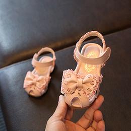 Canada 2019 été enfants sandales filles bébé bébé respirant creux en cuir souple chaussures dentelle arc infantile princesse chaussures Offre