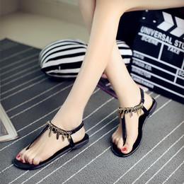 Argentina 2019 nueva moda de verano gladiador sandalias de las mujeres zapatos de borla plana boda sandalias de playa A048 Suministro