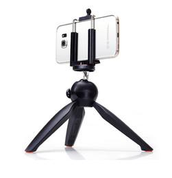 Soporte móvil online-Soporte universal para cámara de teléfono celular Selfie Stick Stand Mount Clip YT-228 Mini trípode para teléfonos móviles Cámara digital con paquete