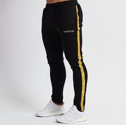 2019 asiatische jogger hose Mens Jogger beiläufiger Sport-lange Hosen Basketball Laufen Fitness Pants Stitching Jogginghose 2 Farben asiatische Größe M-3XL günstig asiatische jogger hose
