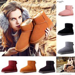 Stivali da neve classici delle donne di alta qualità Breve tubo di cuoio Fondo giusto antiscivolo scarpe da donna calde di cotone Stivali da neve australiani economici da