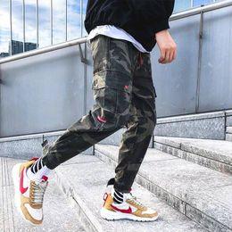 2019 pantalones cool mens 2019 Cool Men Hip Hop Streetwear Moda Pantalón de carga Multi bolsillo Pantalones casuales Hombre Cool Harem Pantalones Jogger Sweatpants para hombre pantalones cool mens baratos