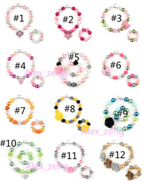 Chunky schmucksets online-72 Design Baby Mädchen Anhänger Chunky Perlenkette Armband Set Amerikanische Flagge Einhorn Diamant Rose Schädel Kopf Bogen Kinder Party Schmuck Geschenk