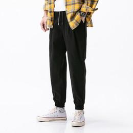 calça de baixo para homem Desconto Designer calças dos homens Calças de marca para homens com padrão listrado da forma Calças Casual Luxo com bolsos para Autumn Altamente qualidade