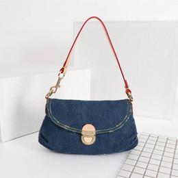 Bolsos de hombro de mezclilla de diseño online-última moda de lujo salvaje denim carta patrón mujer bandolera Diseñador mujer bolso tamaño 26x17x7CM modelo M44470