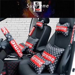 Al por mayor-5 piezas traje cojín del reposacabezas del coche y cojines del asiento de la cubierta del volante sup decoración de la moda almohada del reposacabezas del coche negro desde fabricantes