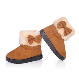 Botas de invierno caramelos online-Dulces de colores Niñas Botas de invierno Niños Botas de algodón cálido con corbatín Niños Botas de nieve Moda Princesa Dulce Antiskid