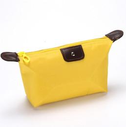 2020 bolsas de cosméticos amarillas casos Venta al por mayor Nueva bolsa de cosméticos de gran capacidad portátil. Bolsas de viaje grandes bolsas de lavado de nylon amarillo impermeable bolsa de almacenamiento Envío gratis rebajas bolsas de cosméticos amarillas casos