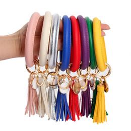 Anéis redondos on-line-Pulseira de couro Chaveiro PU Wrist Key Ring Pingente de Borla Pulseiras Esportes Chaveiro Pulseiras Rodada Chave Anéis Da Festa Favor GGA2577