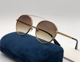 Branded circle sunglasses online-Luxus Designer Mode Marke Kreis Sonnenbrille 0423 Für Männer und Frauen Metallrahmen Klassische Retro Stil Runde Brille UV400 Eyewear Mit Fall
