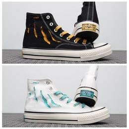 segeltuchschuhe löcher Rabatt 2019 neue Designer Mode Wolf Klaue markiert Löcher schwarz weiß hoch Segeltuchschuhe Männer Frauen Schuhe Mode Leinenschuhe