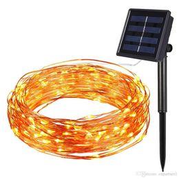 Cable de alimentación plano online-Nueva luz de la secuencia de la energía solar LED impermeable 10m 100 LED lámpara de alambre de cobre blanco cálido para luces de decoración de la lámpara de Navidad al aire libre
