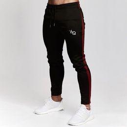 Abbigliamento sportivo nylon da uomo online-Pantaloni sportivi da uomo Pantaloni sportivi Fitness Uomo Abbigliamento sportivo Pantaloni tuta Pantaloni sportivi pantaloni neri Pantaloni da ginnastica Pantaloni da jogging